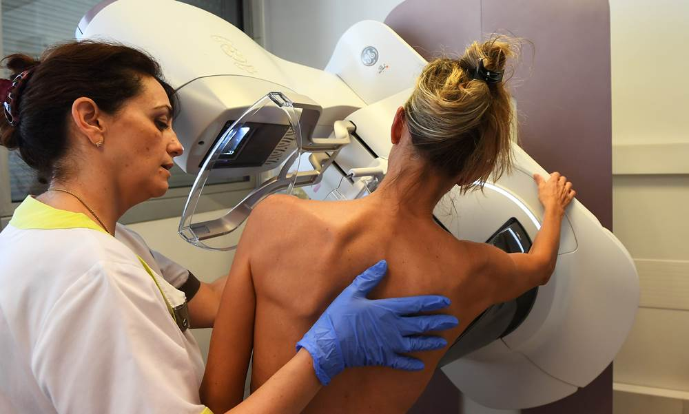 A patient is pictured before a mammography, on October 9, 2017 at the Paoli-Calmette institute, a fight against cancer regional centre.  / AFP PHOTO / ANNE-CHRISTINE POUJOULAT
